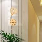 Moderné nástenné svietidlo v tvare kvetu v zlatej farbe na žiarovky typu E14 je svietidlo určené na stenu v modernom vzhľade